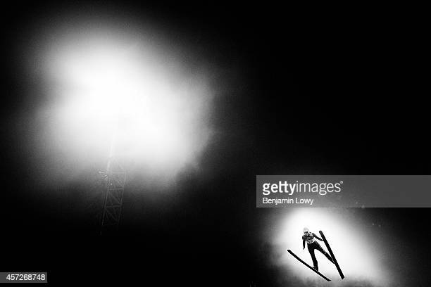 Julia Clair of France during the Ladies' Normal Hill Individual first round on day 4 of the Sochi 2014 Winter Olympics at the RusSki Gorki Ski...