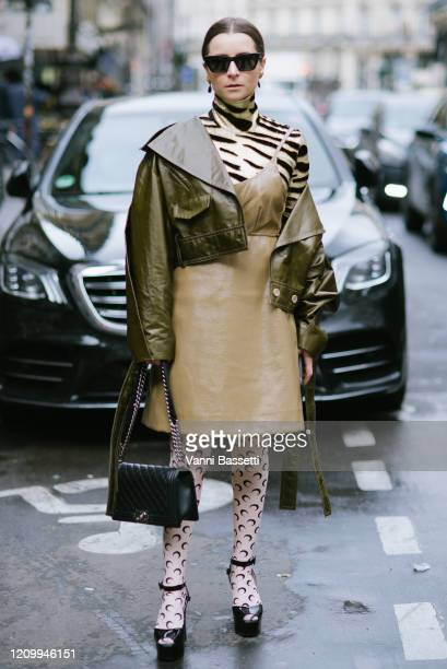 Julia Comil poses wearing Marine Serre stockings and a Chanel bag after the Giambattista Valli show at the Musée des Arts Décoratifs during Paris...