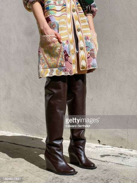 Julia Comil wears a colored floral print wool cardigan from Etro, brown thigh high leather boots from Dorothee Schumacher, during an online remote...