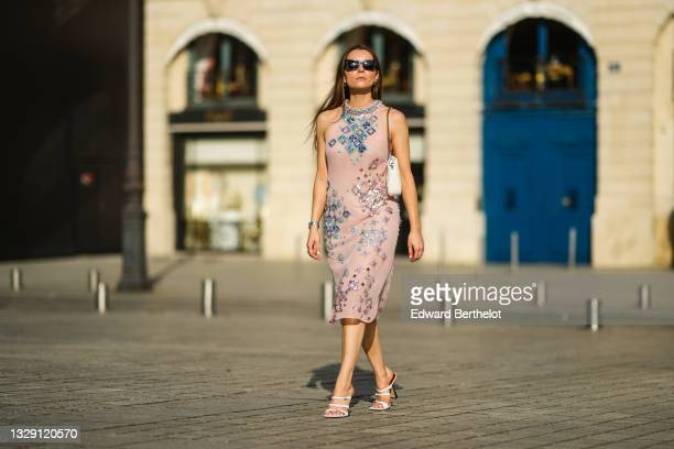 """Julia Comil wears a pink silky sheer embroidered and bejeweled midi dress from Miu Miu, a white """"matelassé"""" nappa quilted leather Bag from Miu Miu,..."""