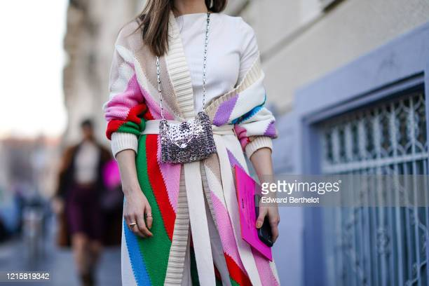Julia Comil wears rings a creamcolor knit coat with a colorful geometric design a white top a metalmesh bag outside MSGM during Milan Fashion Week...