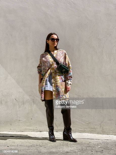 Julia Comil wears sunglasses from Chanel, a colored floral print wool cardigan from Etro, a green leather belt bag from Faure Le Page, French terry...
