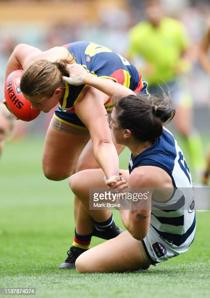 Julia CrockettGrills of the Cats tackles Chloe Scheer of the Adelaide Crows during the AFLW Preliminary Final match between the Adelaide Crows and...