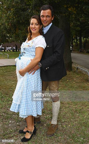 Julia Dahmen and Carlo Fiorito attend a party at Hippodrom beer tent during day 2 of Oktoberfest beer festival on September 21 2008 in Munich Germany