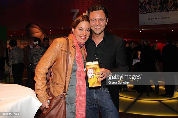 Julia Dahmen and her husban Carlo attend the premiere of the film 'Irre sind maennlich' at Mathaeser Filmpalast on April 10 2014 in Munich Germany