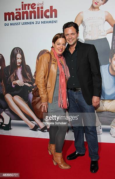 Julia Dahmen and her husband Carlo attend the premiere of the film 'Irre sind maennlich' at Mathaeser Filmpalast on April 10 2014 in Munich Germany