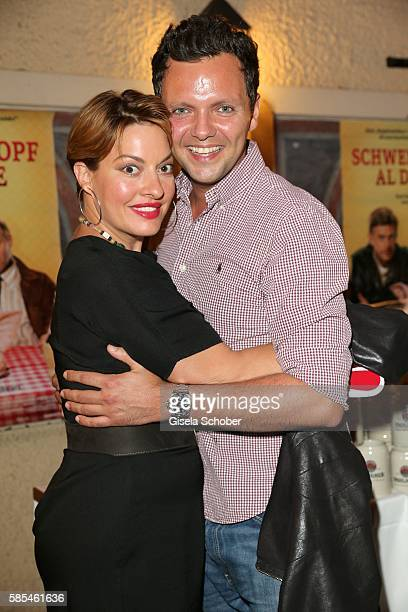Julia Dahmen and her husband Carlo Fiorito during the premiere of the film 'Schweinskopf al dente' after party at restaurant 'Zum Straubinger' on...