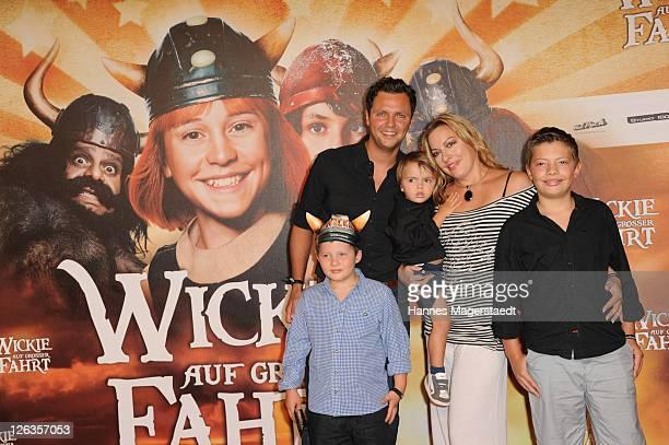 Julia Dahmen and husband Carlo and their kids Emilio Mikosch and Joshua attend the 'Wickie Auf Grosser Fahrt' 3D Premiere at the Mathaeser Filmpalst...