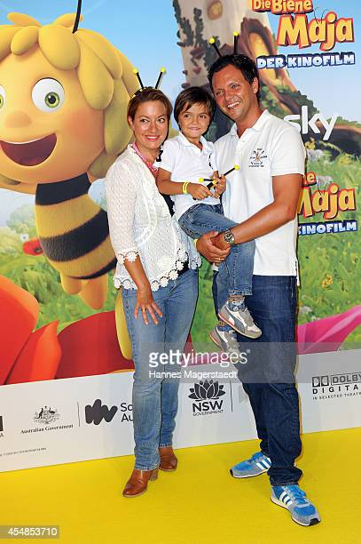 Julia Dahmen with husband Carlo Fiorito and son Emilio attend the German premiere of the film 'Die Biene Maja Der Kinofilm' at Mathaeser Filmpalast...