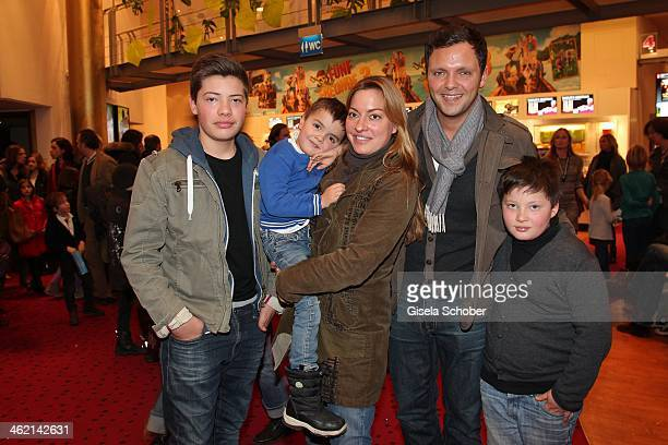 Julia Dahmen with husband Carlo son Joshua Emilio and Mikosch attend the premiere of the film 'Fuenf Freunde 3' at Cinemaxx on January 12 2014 in...