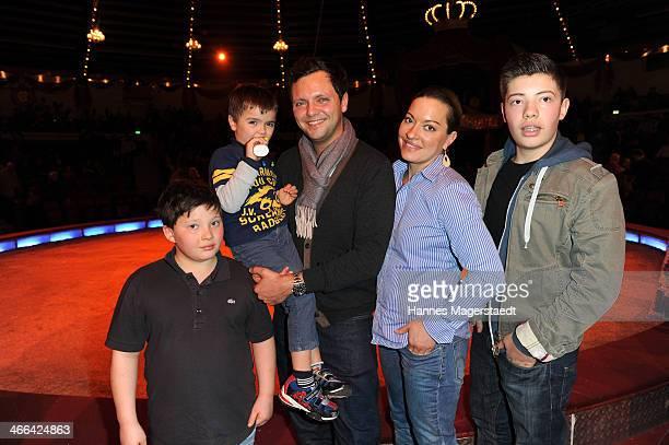Julia Dahmen with husband Carlo son Joshua Emilio and Mikosch attend the Circus Krone Show Premiere at Circus Krone on February 1 2014 in Munich...