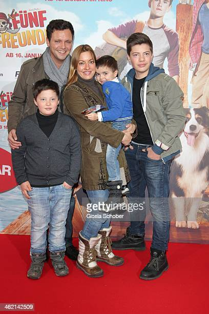MUNICH GERMANY JANUARY Julia Dahmen with husband Carlo son Mikosch Emilio and Joshua attend the premiere of the film 'Fuenf Freunde 3' at Cinemaxx on...
