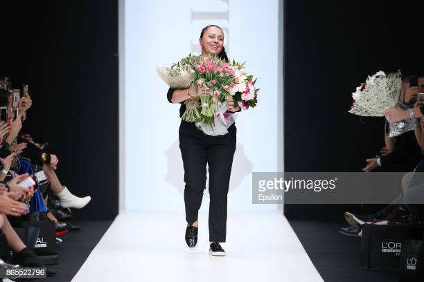 Julia Dalakian walks the runway at the Julia Dalakian fashion show during day three of Mercedes Benz Fashion Week Russia S/S 2018 at Manege on...