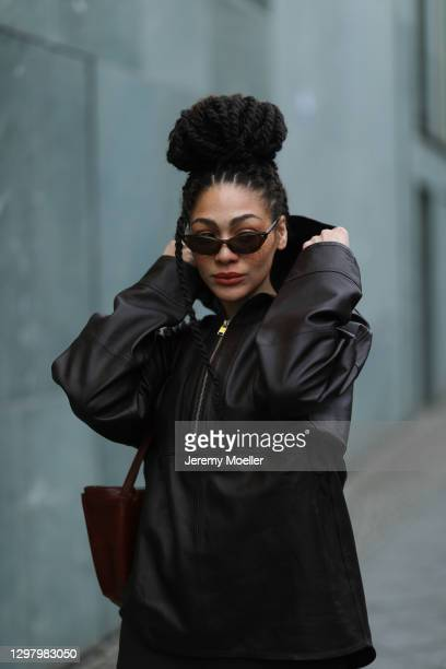 Julia Dalia wearing Chanel shades, Tiger of Sweden brown leather jacket and leather bag during the Mercedes-Benz Fashion Week Berlin January 2021 on...