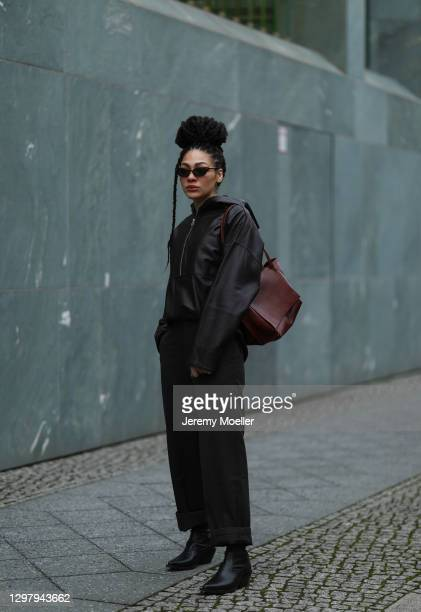 Julia Dalia wearing Chanel shades, Tiger of Sweden brown leather jacket, Uniqlo leather pants, leather bag and Hope boots during the Mercedes-Benz...