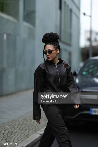 Julia Dalia wearing Chanel shades, Tiger of Sweden brown leather jacket, Uniqlo leather pants and leather bag during the Mercedes-Benz Fashion Week...