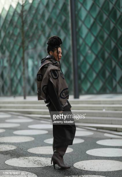 Julia Dalia wearing Ray Ban shades, Chloe brown scarf, Tiger of Sweden brown leather jacket, Tiger of Sweden leather skirt and Gia Couture boots...