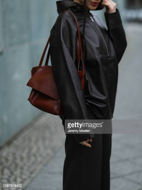 Julia Dalia wearing Tiger of Sweden brown leather jacket, Uniqlo leather pants and leather bag during the Mercedes-Benz Fashion Week Berlin January...