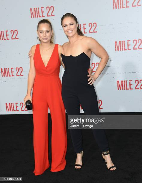 Julia De Mars and Ronda Rousey arrive for the Premiere Of STX Films' 'Mile 22' held at Westwood Village Theatre on August 9 2018 in Westwood...