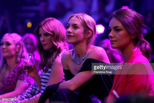 Julia Dietze and Janina Uhse attend the Guido Maria Kretschmer Fashion Show Autumn/Winter 2017 presented by OTTO at Tempodrom on July 5, 2017 in...