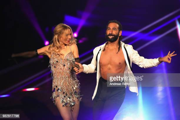 Julia Dietze and Massimo Sinato perform on stage during the 1st show of the 11th season of the television competition 'Let's Dance' on March 16 2018...