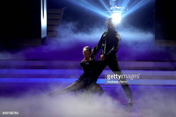 Julia Dietze and Massimo Sinato perform on stage during the 5th show of the 11th season of the television competition 'Let's Dance' on April 20 2018...