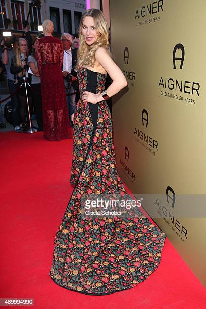 Julia Dietze wearing a dress by Aigner during the 50th Anniversary of AIGNER on April 16 2015 in Munich Germany