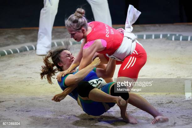 Julia Dorny of Germany competes against Luciana Montogomery Higuchi of Brazil during the Sumo Open Weight Women's Competition of The World Games at...