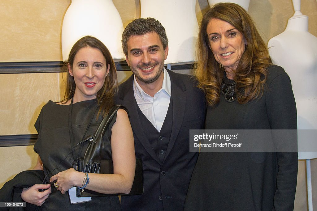 Julia Duhamel, Press and Communications Officer, H & M France, Thomas Lourenco, CEO of H & M France, and Dominique Fantaccino, Director of Human Resources of H & M France, attend the Maison Martin Margiela for H&M collection launch at H&M Champs Elysees on November 14, 2012 in Paris, France.