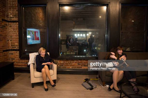 Julia Fiori and Ella Hannaford hug while they wait for governors race results for Fiori's aunt candidate Janet Mills left near midnight at an...