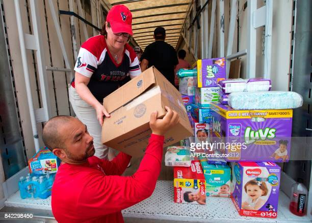 Julia FitzGerald helps unload a truck of relief supplies for people impacted by Hurricane Harveyon September 3 in Houston NFL Houston Texans...