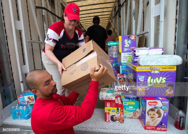 Julia FitzGerald helps unload a truck of relief supplies for people impacted by Hurricane Harvey on September 3 in Houston Texas JJ Watt's Hurricane...