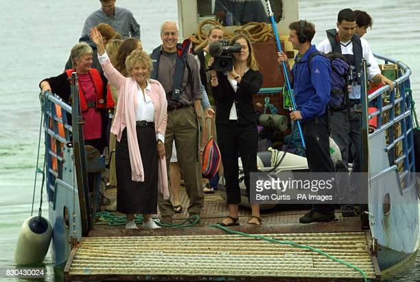 Julia Fogle waves to her son BBC Castaway contestant Ben next to his father Bruce whom he has not seen for seven months as the boat arrives for the...