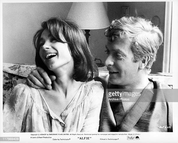 Julia Foster and Michael Caine laughing in a scene from the film 'Alfie', 1966.