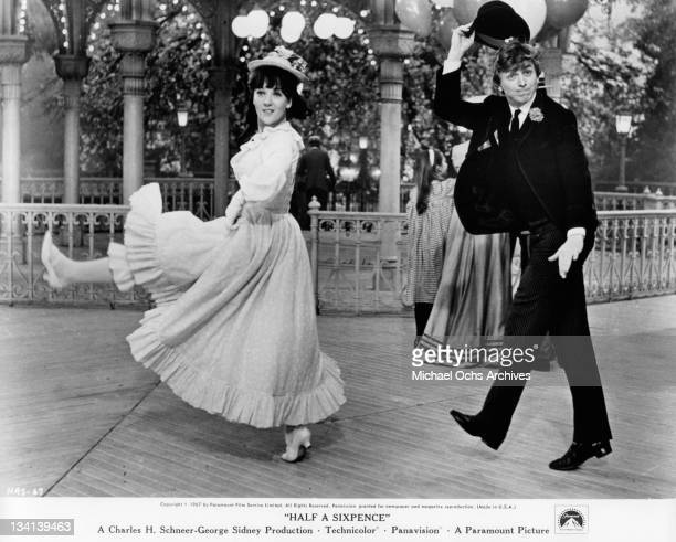 Julia Foster and Tommy Steele dancing in a scene from the film 'Half A Sixpence', 1967.