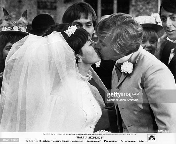 Julia Foster and Tommy Steele kissing in a scene from the film 'Half A Sixpence', 1967.