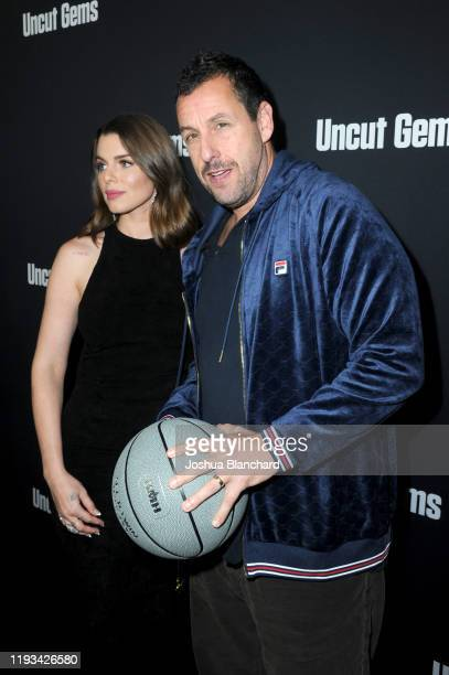 Julia Fox and Adam Sandler attend the Los Angeles premiere of Uncut Gems on December 11 2019 in Los Angeles California