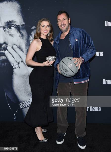 Julia Fox and Adam Sandler attend the premiere of A24's Uncut Gems at The Dome at ArcLight Hollywood on December 11 2019 in Hollywood California