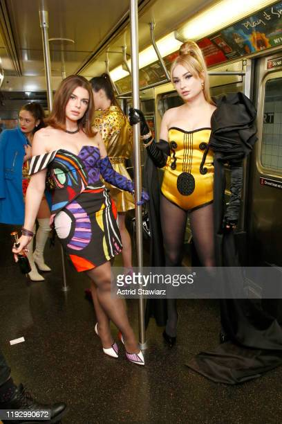 Julia Fox and Kim Petras attend the Moschino Prefall 2020 Runway Show front row at New York Transit Museum on December 09 2019 in Brooklyn City