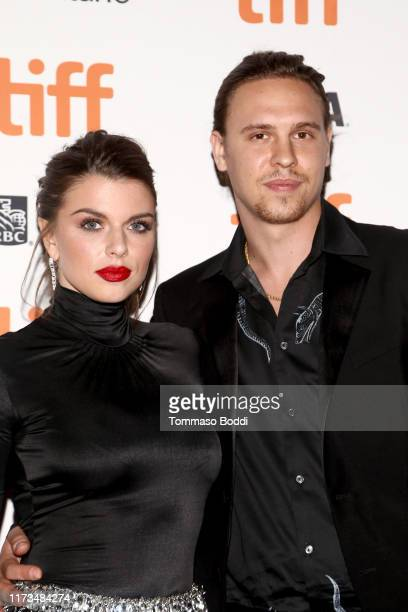 """Julia Fox and Peter Artemiev attend the """"Uncut Gems""""premiere during the 2019 Toronto International Film Festival at Princess of Wales Theatre on..."""