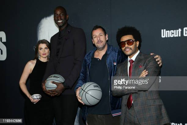 """Julia Fox, Kevin Garnett, Adam Sandler and The Weeknd attend the premiere of A24's """"Uncut Gems"""" at The Dome at Arclight Hollywood on December 11,..."""
