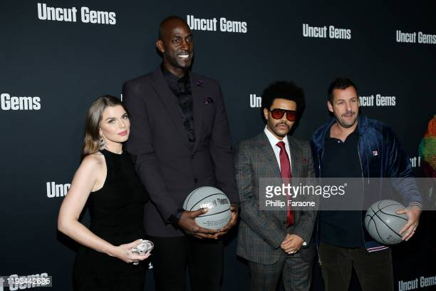 Julia Fox Kevin Garnett The Weeknd and Adam Sandler attend the premiere of A24's Uncut Gems at The Dome at Arclight Hollywood on December 11 2019 in...