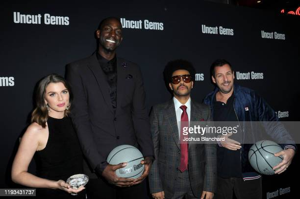 Julia Fox Kevin Garnett The Weeknd and Adam Sandler attends the Los Angeles premiere of Uncut Gems on December 11 2019 in Los Angeles California