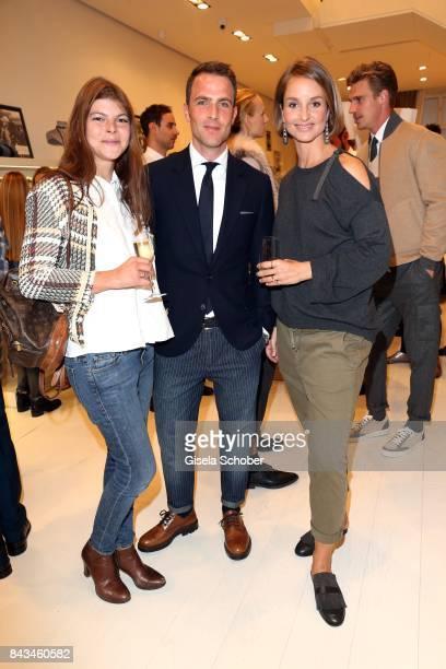 Julia FrankTewaag daughter of Uschi Glas Michael Meyer managing director Brunello Cucinelli Germany and Lara Joy Koerner during the Brunello...