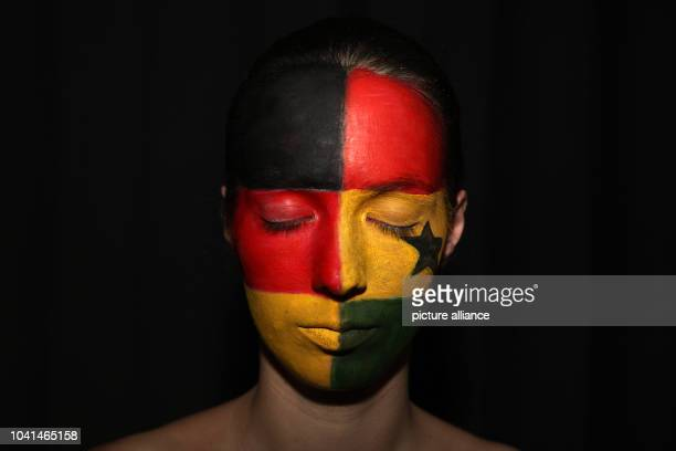 ILLUSTRATION Julia Gastel has her face painted in the colours of the German and Ghanaian flag in Duesseldorf Germany 11 June 2014 The German national...