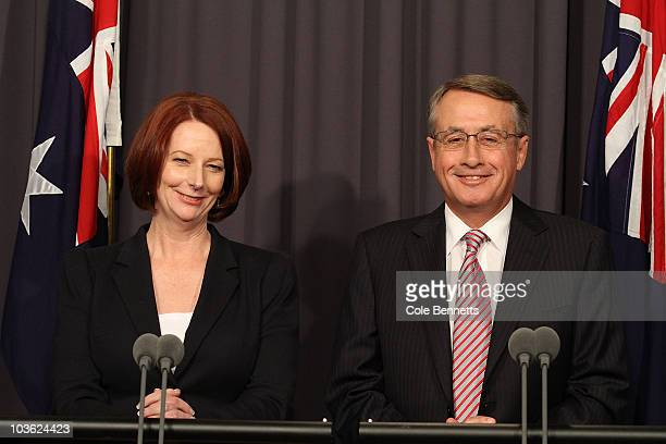 Julia Gillard and Wayne Swan speak during a press conference at National Press Club on August 25, 2010 in Canberra, Australia. The 3 Independents and...