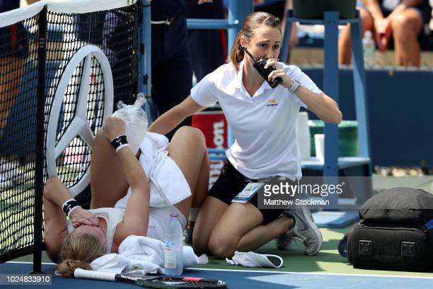 Julia Glushko of Israel receives treatment on the court during her women's singles first round match against Monica Niculescu of Romania on Day Two...
