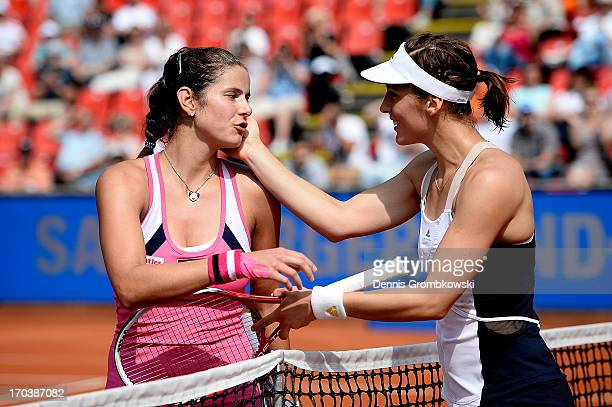 Julia Goerges and Andrea Petkovic of Germany hug after their second round match during day five of the Nuernberger Insurance Cup on June 12, 2013 in...