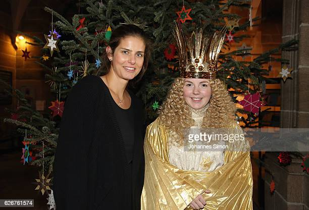 Julia Goerges German ATP tennis player and actress Barbara Otto dressed as 'Nuremberg Christkind' pose at town hall near Nuremberg Christmas market...