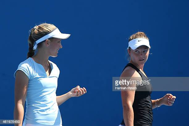 Julia Goerges of Germany and AnnaLena Groenefeld of Germany talk tactics in their first round doubles match against Maddison Inglis of Australia and...